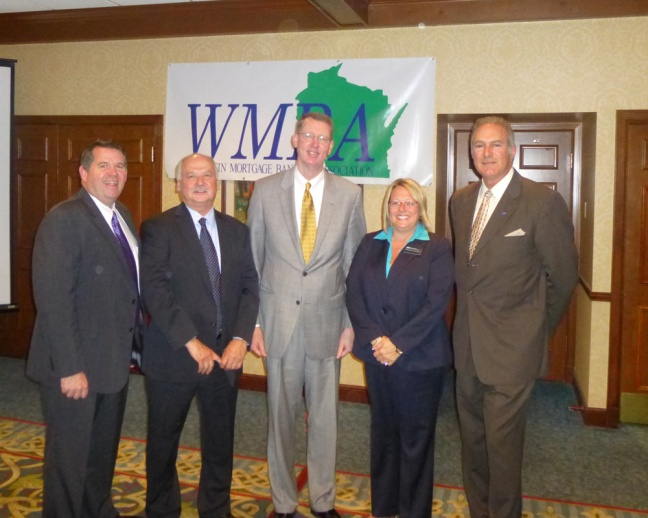 Pictured above, left to right, are: John Watry, Chief Financial Officer, Inlanta Mortgage; John Knowlton, Chief Executive Officer, Inlanta Mortgage; Peter Bildsten, DFI Secretary; Georgia Maxwell, DFI Executive Assistant; and Nicholas DelTorto, President, Inlanta Mortgage.