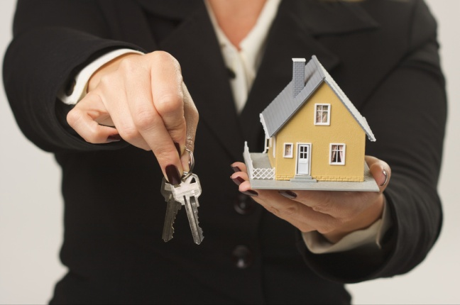 House and Keys in Female Hands